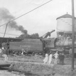 On August 24, 1942 a Pennsy westbound train cleared the Plymouth, Indiana interlocking plant and stopped in the westward passing track. The tower operator lined up a northbound Nickel Plate train, as the NKP train approached the crossing, the PRR train decided to shove back. No one was properly protecting the back-up move and they shoved through the derail and onto the diamond where a gondola car derailed. Photo from the Bob Albert collection.