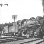 Smoke is apparently not an issue on this day in 1946 as Nickel Plate #626 heads north across the Wabash at Peru, Indiana. The Nickel Plate made a sharp curve here, crossed the Wabash and started a steep uphill climb to Denver. Helpers were a normal routine leaving the Wabash River valley. Take note of the tilting target signal, these were very common on the IMC District and a few still exist. Also of note is the rider car behind the engine, these were common on locals to accommodate an extra brakeman and LCL shipments. Photo is courtesy of M. D. McCarter Photographs Photographs, please check our links page for his catalog.