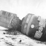 On February 3, 1962 a westbound New York Central freight train rear-ended another just east of Walkerton, Indiana. Four crewmen were injured and the caboose was destroyed, that is part of it under the boxcar. The locomotive facing the boxcar is an Alco FA2 #1076. Photo from Bob Albert.