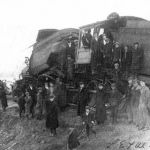 On Friday, March 22, 1912, the Lake Erie & Western had a head-on collision south of Plymouth, Indiana at Lake Muckshaw. Eleven passengers and four railroad employees were injured. Passenger train #25 left the Plymouth station five minutes earlier than their wait order stated and met a doubleheaded freight train just south of town. The passenger engine (on left) was driven back by the impact of the collision. Unknown photographer.