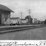 The Pennsy depot at Hanna, Indiana was located on the south side of the track at Wheeler Street. The depot was a standard PRR small town depot, which were in several towns in this area. At the far right you can see the tower at the Pere Marquette crossing. Postcard from Bob Albert collection.