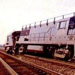 On March 24, 1963 a Pennsy westbound freight derailed at Hanna, Indiana at the former Pere Marquette crossing. The line parallels U.S. 30, which was just to the north of the right-of-way. This made for easy viewing of the clean up. Six month old U25B 2515 was also derailed, while a sister engine remained on the track. Photo by Bob Albert.