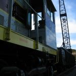 In June of 2009, we used EL 310, our NKP gon, and our Orton rail crane to fill in a small washout along the tracks.