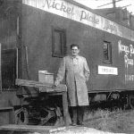 "Agent Herb Blocker shows off his ""new"" depot at Tippecanoe, Indiana sometime after the December 23, 1951 wreck. This served as the depot until the agency was closed. The caboose is a World War 2 era rebuild from a box car. The Nickel Plate, along with other railroads, had a severe caboose shortage during the war. Unknown photographer."