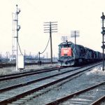 On March 31, 1972 a Southern Pacific U33C #8653 is leading an eastbound Erie Lackawanna train over the Grand Calumet River swing bridge at Hammond, Indiana. The Nickel Plate also used this bridge; the Monon bridge is on the left, hidden by the train, Photo by George Kantola, HVRM collection.