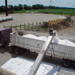 Here we see fertilizer being loaded onto a truck for further distribution.  The fertilizer was brought in via rail.