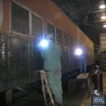 In this photo, Andy Hershman and Josh Meanovich continue to weld on the Long Island coach 2937.