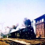 On March 22, 1958, B&O 4-8-2 720 is eastbound with a passenger train at Walkerton, Indiana. The train is crossing the New York Central and is about to cross the Nickel Plate. The tower and freight house stand in a triangle between the three railroads. The freight house is gone but, the tower is still standing. The top floor burned in the 1960s and the tower was rebuilt with only two floors. Photo by Sandy Goodrick.