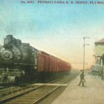 This postcard (post marked 1911) view is looking west at Plymouth, Indiana after the 1903 double tracking of the Pennsy. The tower is visible, behind the platform shelter on the left and a signal bridge is the background. The water tank is just west of the Vandalia and Lake Erie & Western diamonds. The depot was later replaced with a red brick structure, which still stands. Postcard from Bob Albert collection.