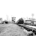 Alida, Indiana was the junction of the Baltimore & Ohio's Chicago line and the Monon's Michigan City branch. The interchange track is visible between the house and the tower. On October 6, 1956 eastbound B & O 2-8-2 #4635 is just crossing the Monon. All the building in the picture and the Monon are now gone, only a handful of houses remain. Photo is courtesy of M. D. McCarter Photographs, please check our links page for his catalog.