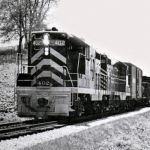 Nickel Plate train 86 climbs out of the Wabash River valley north of Peru, Indiana. Engineer C. V. Gross certainly had his work cut out for him, as this train has just left the yard at the bottom of this 1.6 per cent grade. The railroad has been removed between Rochester and Kokomo. This photo appeared on the cover of the Nickel Plate employee magazine's May/June 1960 issue. NKP photo.